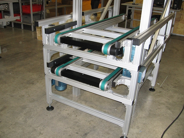 Two timing belt conveyors stacked on top of each other
