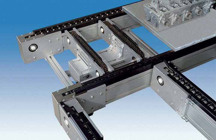 Pallet conveyor lift and transfer with chain conveyor