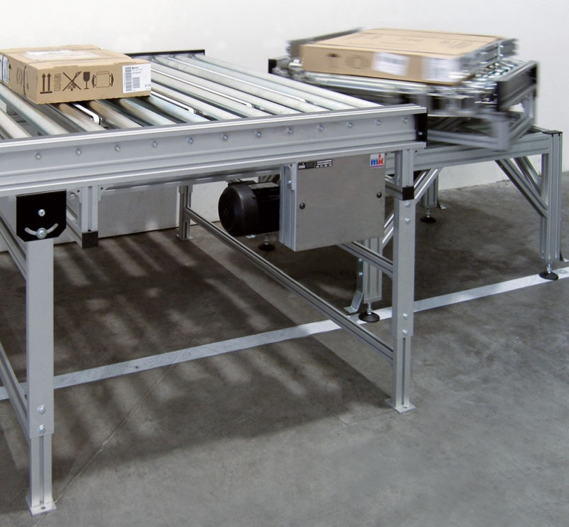 Powered roller conveyors with turn table