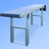 Flat belt conveyor with adjustable supports