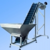 Green cleated belt conveyor with hopper