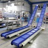 Inclined plastic modular belt conveyors with blue belts