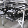Wide multi lane conveyor carrying molded parts
