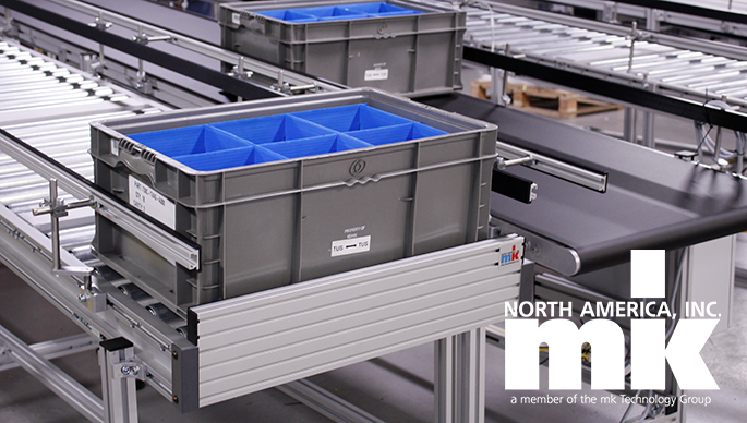 Gravity roller conveyor carrying plastic tote