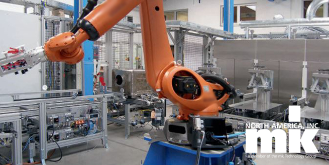 Robot with conveyors in the background