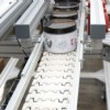 conveyor carrying lotion containers