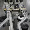 Four lanes of flexible table top chain conveyors