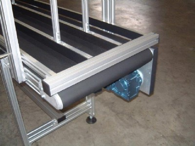 An mk flat belt conveyor with lane dividers.