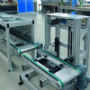 Over under timing belt pallet system with vertical transfer unit