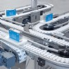 Flexible chain conveyors with batteries of pallets